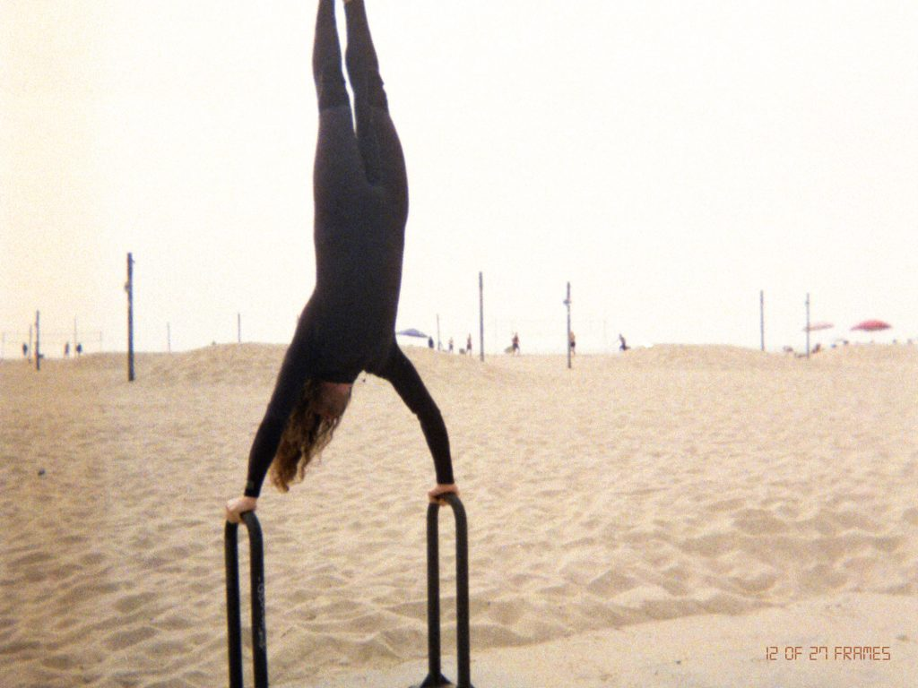 Ben Rabb, co-founder of and repeat, doing a handstand on a bike rack as his second ritual.