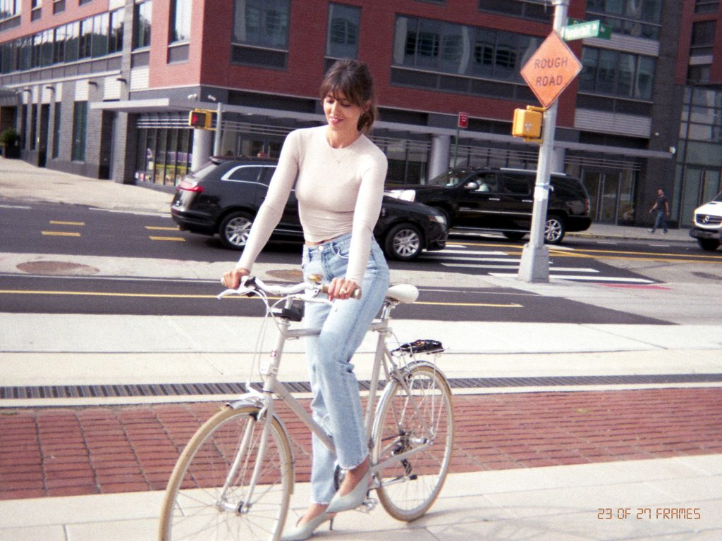 Violette fr riding a bike in New York